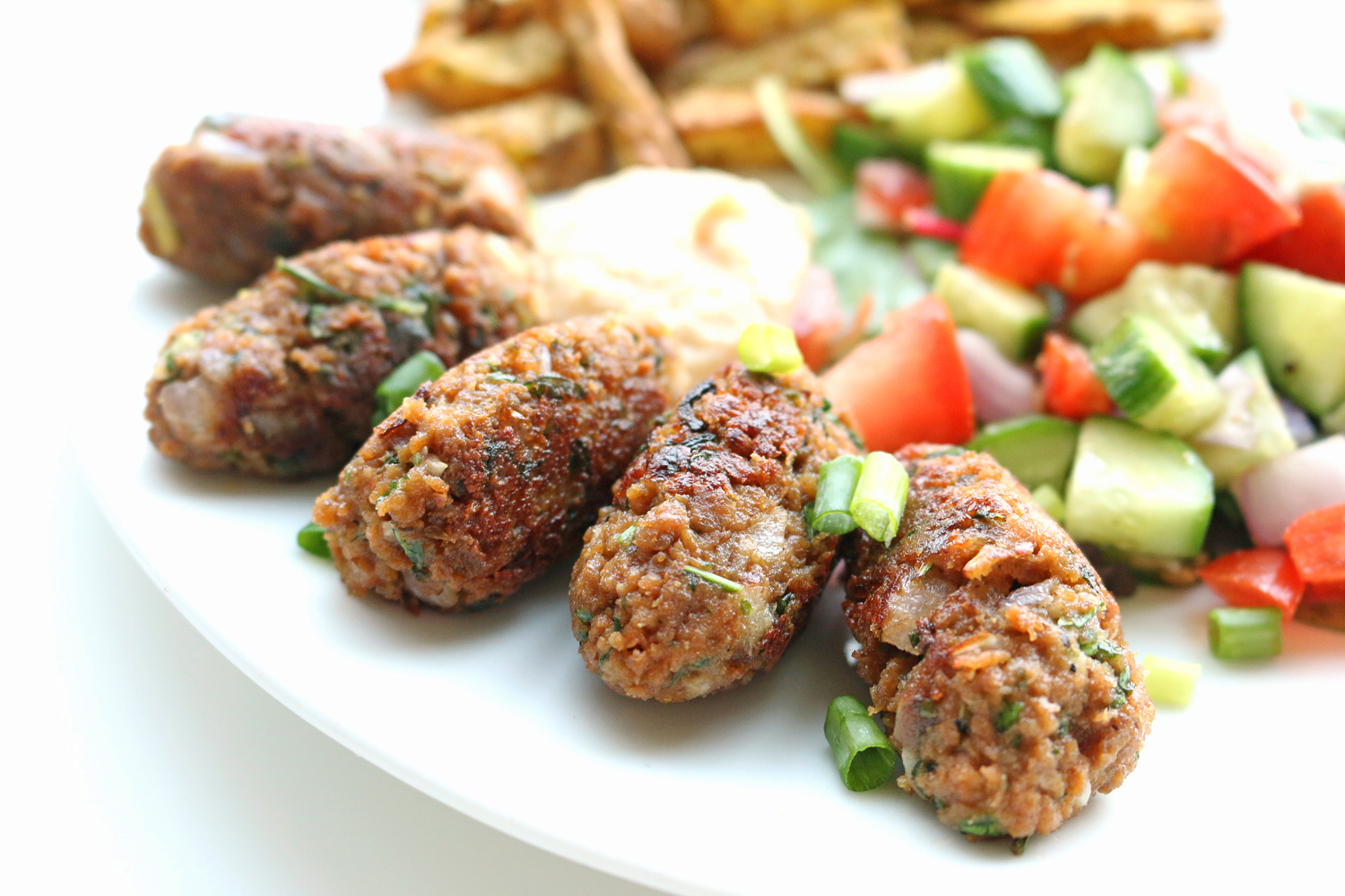 dadddef903e I paired my Koftas with a simple Baladi-style salad of cucumbers, tomatoes  and onions in a cumin vinaigrette, a dollop of hummus as well as some  Za'atar ...